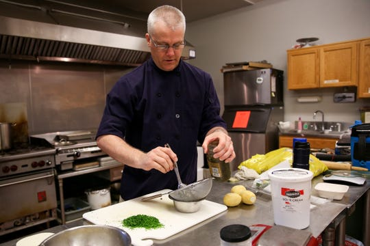 Soup 'R Meals chef, Todd Wieweck, prepares a salmon seasoning at the South Salem Senior Center on Monday, Oct. 8, 2018. The prepared meal service opened in 2017.