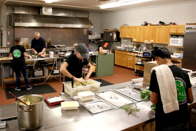 Soup 'R Meals workers prepare meal plan packages at the South Salem Senior Center on Monday, Oct. 8, 2018.