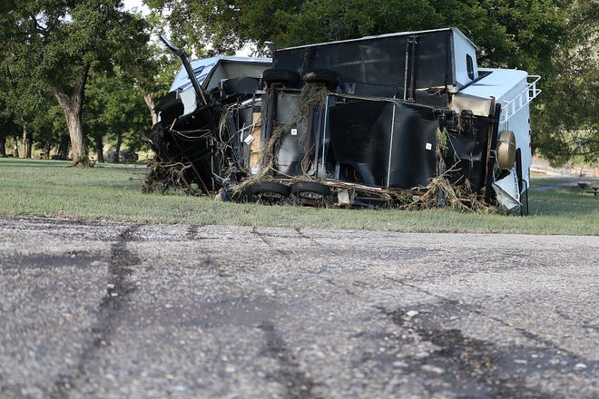 Scratch marks on the asphalt were caused by an overturned RV that was carried away by raging flood waters  near the South Llano River Bridge Monday, Oct. 8, 2018 in Junction, Texas after heavy rainfall washed away a nearby RV park.