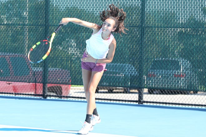 San Angelo Central High School's Olivia Henderson hits a serve during practice at the Tut Bartzen Tennis Center on Wednesday, Oct. 3, 2018.