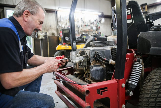 Lloyd Arms repairs a lawnmower Tuesday, Oct. 9, 2018, at Concho Power Equipment.