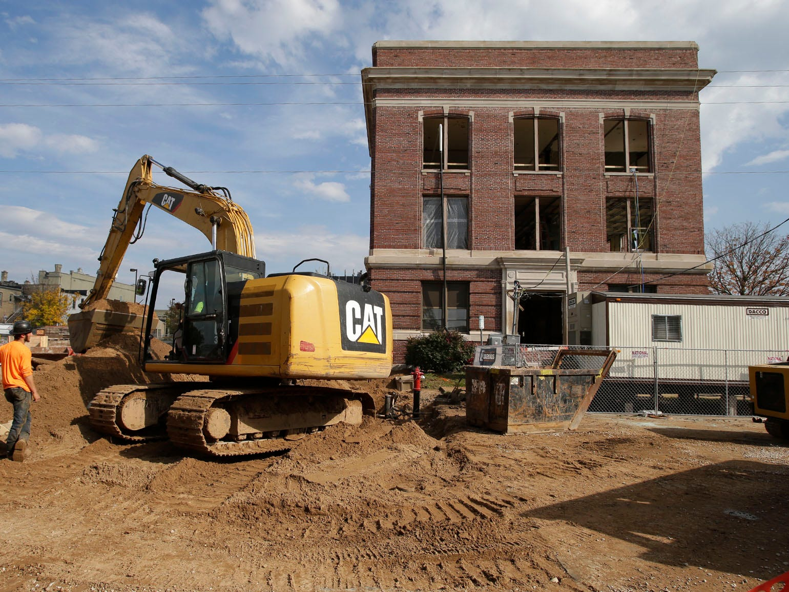Road construction equipment works on infrastructure near Sheboygan City Hall as the building is being refurbished, Tuesday, October 9, 2018, in Sheboygan, Wis.