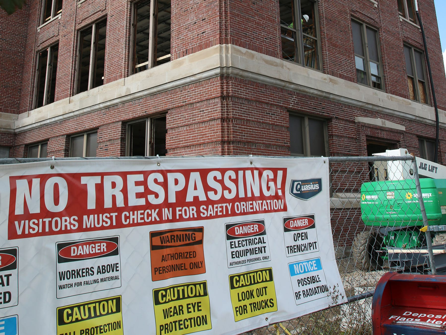 The southeast corner of Sheboygan City Hall features caution signs, Tuesday, October 9, 2018, in Sheboygan, Wis. The city is doing a multi-million dollar renovation of the structure.
