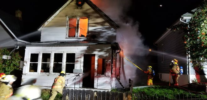 Firefighters battle a house fire in Lead that left two people dead. The cause of the fire is still under investigation.
