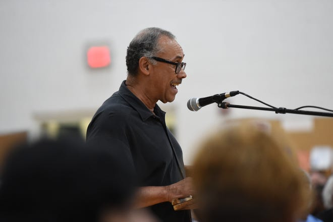 The Rev. Edward Scott, whose But The Name Hurts signs provided a counter to the Save the Name Signs, talks during a public input session before Monday's school name vote. Staunton, Va., School Board voted 4-2 Monday, Oct. 8, 2018 to drop the Robert E. Lee name from the city's only high school. The new name and exact timing are to be determined after more study and public input.