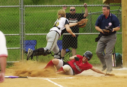 Riverheads' Marsha Carwell slides home during a 2001 softball game. Carwell was inducted into the school's hall of fame this year.