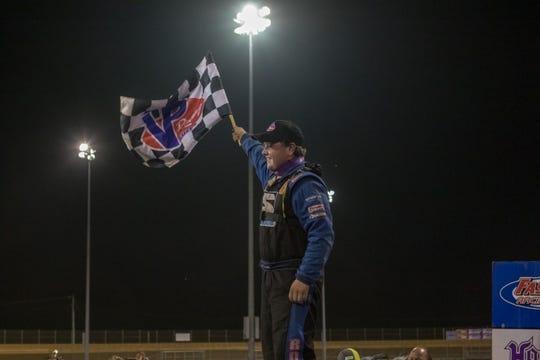Logan Roberson celebrates his victory Saturday in the FASTRAK World Championship race at Virginia Motor Speedway.