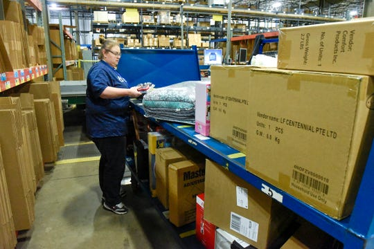 Erin Hammond fulfills order in the packing department at Fingerhut Saturday, Oct. 6, in St. Cloud. Fingerhut is looking to hire 500 people at its St. Cloud fulfillment center for its peak holiday season.