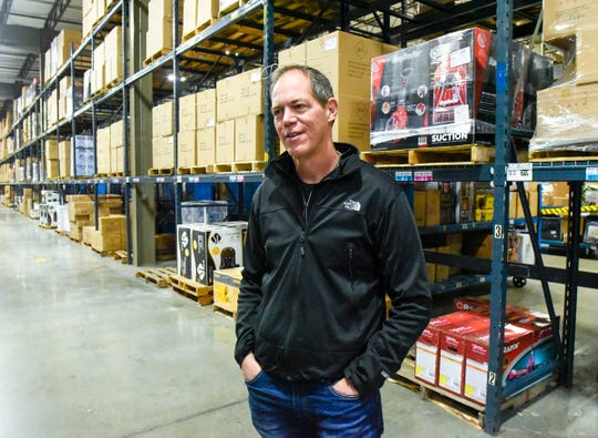 Mike Murray, Bluestem Brands vice president of supply chain and fulfillment, talks about the company during an open house Saturday, Oct. 6, in St. Cloud. Fingerhut is looking to hire 500 people at its St. Cloud fulfillment center for its peak holiday season.
