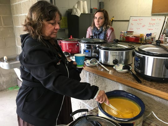 Susan Egbers and daughter Sarah Paper preparing the eight different types of soup Susan made for the cyclists at the Dirt Bag bike ride.