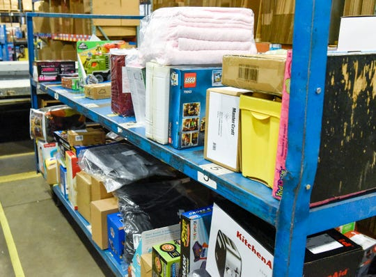 Carts of merchandise are rolled into the packing and shipping department at Fingerhut Saturday, Oct. 6, in St. Cloud.