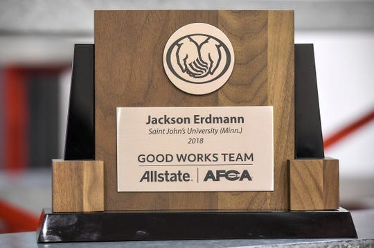 Quarterback Jackson Erdmann receives the Allstate AFCA Good Works Team award for his volunteer work Tuesday, Oct. 9, after practice at St. John's University.