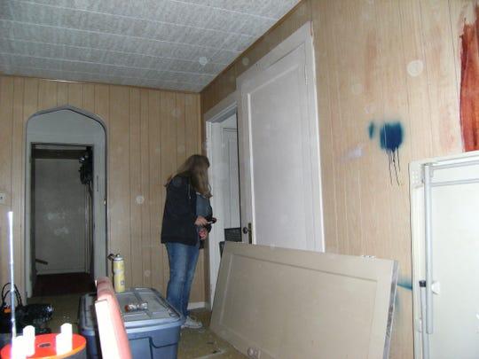 Tina Lloyd investigates an abandoned apartment building.