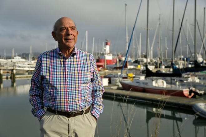 Gerry Goldsholle poses for a photo by a harbor outside his office in Sausalito, California, on Sept. 25, 2018. He just celebrated his 78th birthday, and he's still working.