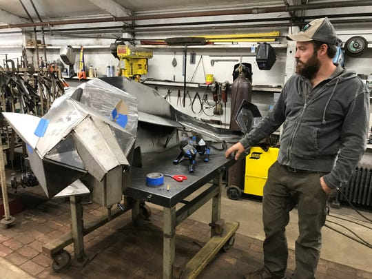 August Kochanowski looks over the work so far done on the stylized metal sculpture of a panther. When it's complete, the piece will end up on the Stevens Point Area Senior High School campus.