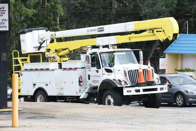 Linemen trucks, like this one on Tuesday afternoon, have become a more frequent sighting around Tallahassee in advance of Hurricane Michael.