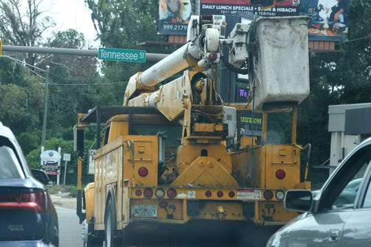 Linemen trucks like this one of Tuesday are a more frequent sighting around Tallahassee in advance of Hurricane Michael, which is expected to knock out power in the capital city.