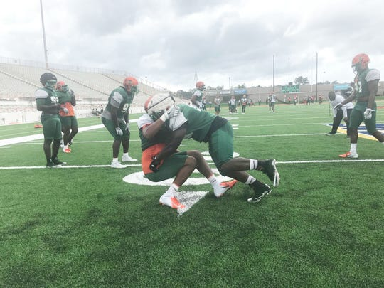 FAMU players go through tackling drills in practice for North Carolina A&T State.