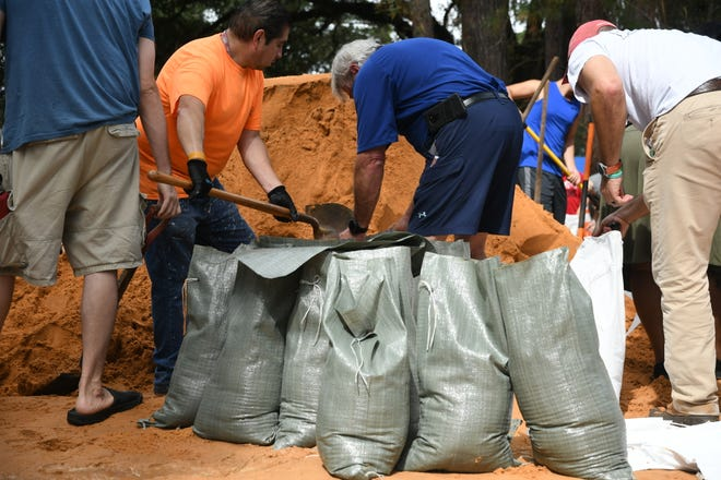 Tallahassee community members come together at Winthrop Park to make sandbags in preparation for Hurricane Michael on Tuesday, Oct. 9, 2018.