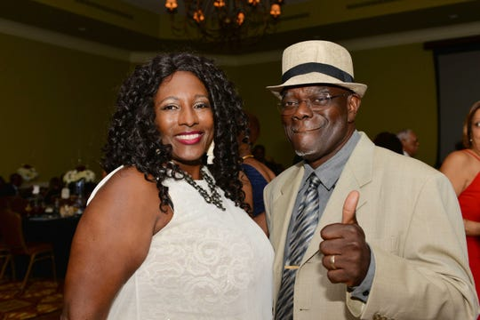 Ozzie and Harriet Edwards sway to the reggae beat at the Caribbean American Cultural Group's Fall Dinner Ball at the Island Club at PGA Village.