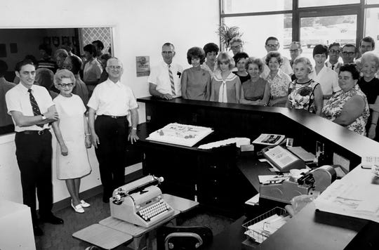 John J. Schumann Jr. (from left), his parents Ruth Schumann and John J. Schumann Sr. help celebrate a milestone with staff members in the lobby of the Press Journal building in the early 1970s. The Press Journal office was located at 1801 U.S. 1 at that time.