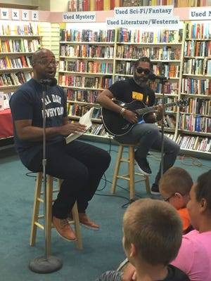 """Kwame Alexander (left) and Randy Preston conduct a literary concert at Vero Beach Book Center. Alexander is a New York Times bestselling author. His latest young adult book is """"Swing"""" which combines baseball, jazz, social justice and love."""