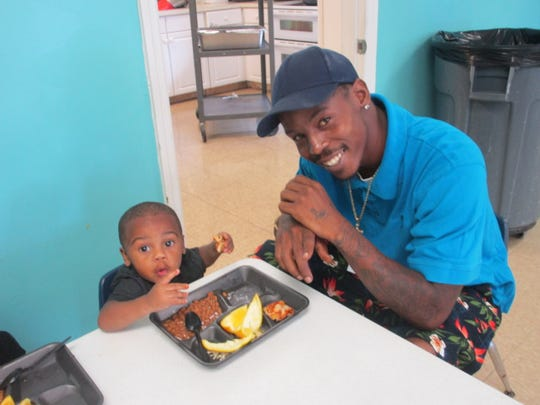 """Messiah Southern and father Dominic Southern at Gertrude Walden Child Care Center on Sept.26for """"Take Your Dad to School Day."""""""