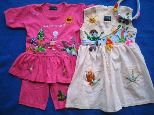 Davie's Judith Dam creates custom children's clothing with exquisite embroidery.