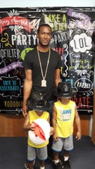 """Kyle Patterson Sr. with sons Kyle Jr. and Kaj Patterson at Gertrude Walden Child Care Center on Sept.26for """"Take Your Dad to School Day."""""""
