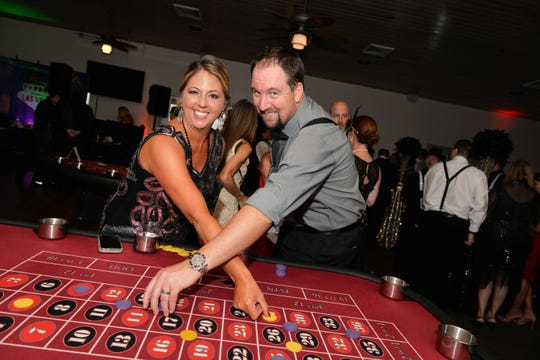 Renee Thompson and Peter Barnard criss-cross and hope to win like a boss at Indian Riverside Park for Casino Night, a fundraiser for Elev8Hope.