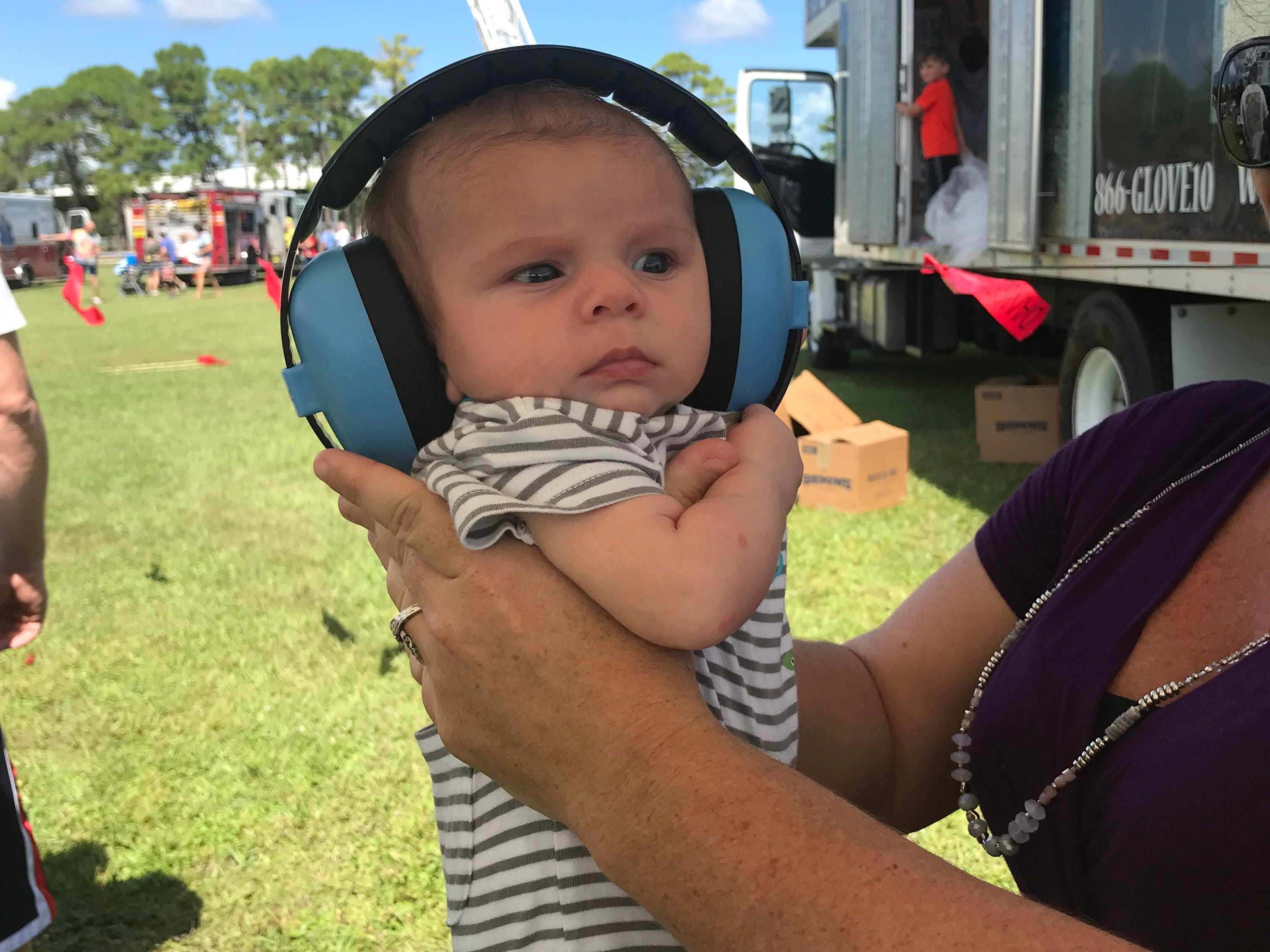 Head phones ensured this baby was not bothered by the honking trucks.