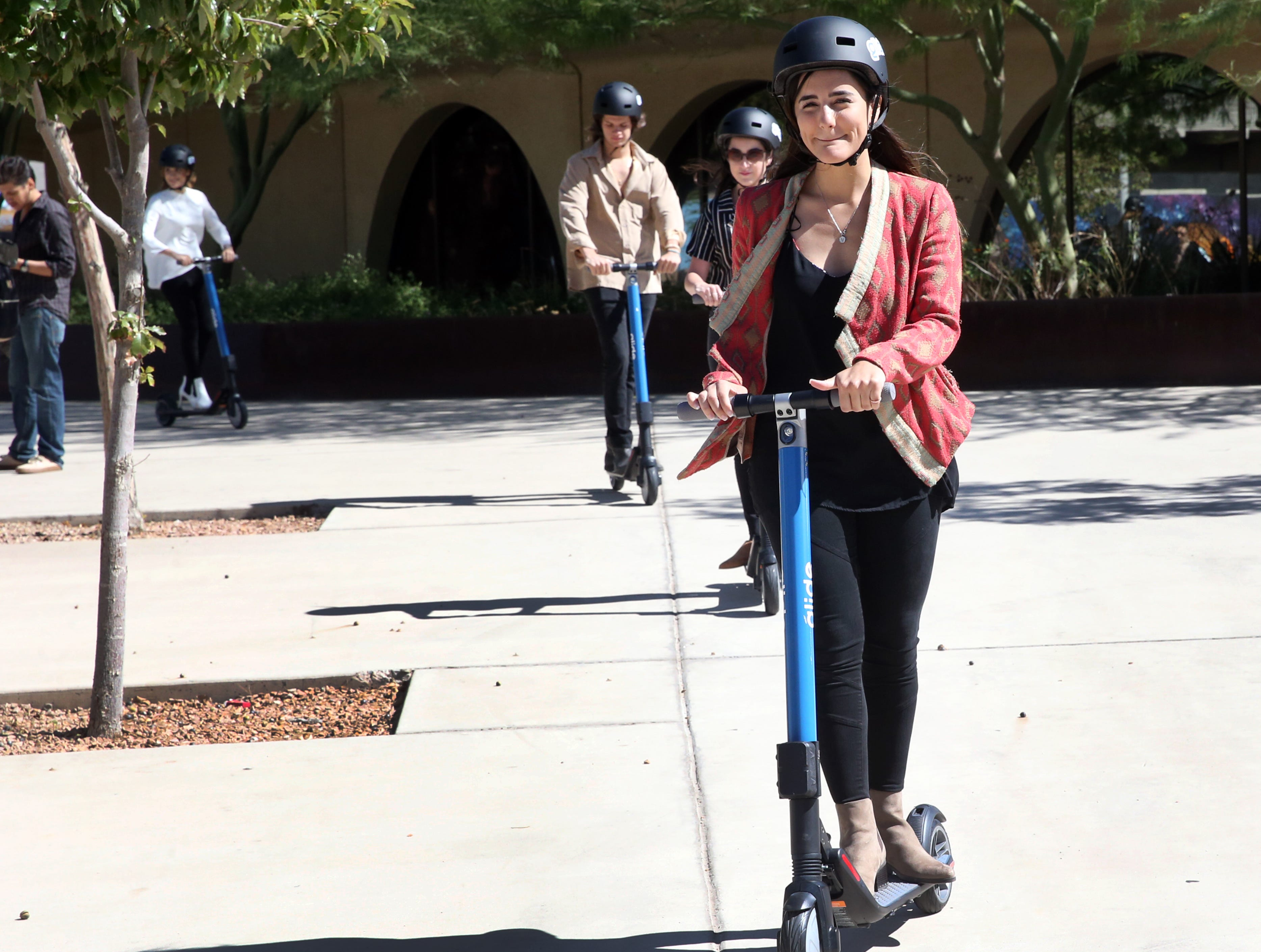 The new Glide scooters are demonstrated Tuesday at the El Paso convention center.