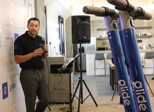 Jonathan Lopez, CEO of Glide Scooter Sharing LLC, announces the launch of the electric scooter rental service during a news conference Tuesday, Oct. 9, 2018, in Downtown El Paso.