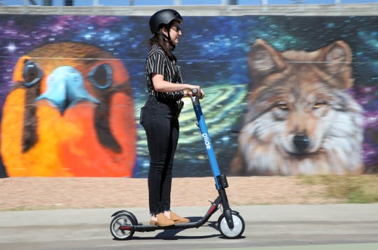 Jackie Padilla tests a Glide electric scooter at the El Paso company's launch event on Oct. 9, 2018.