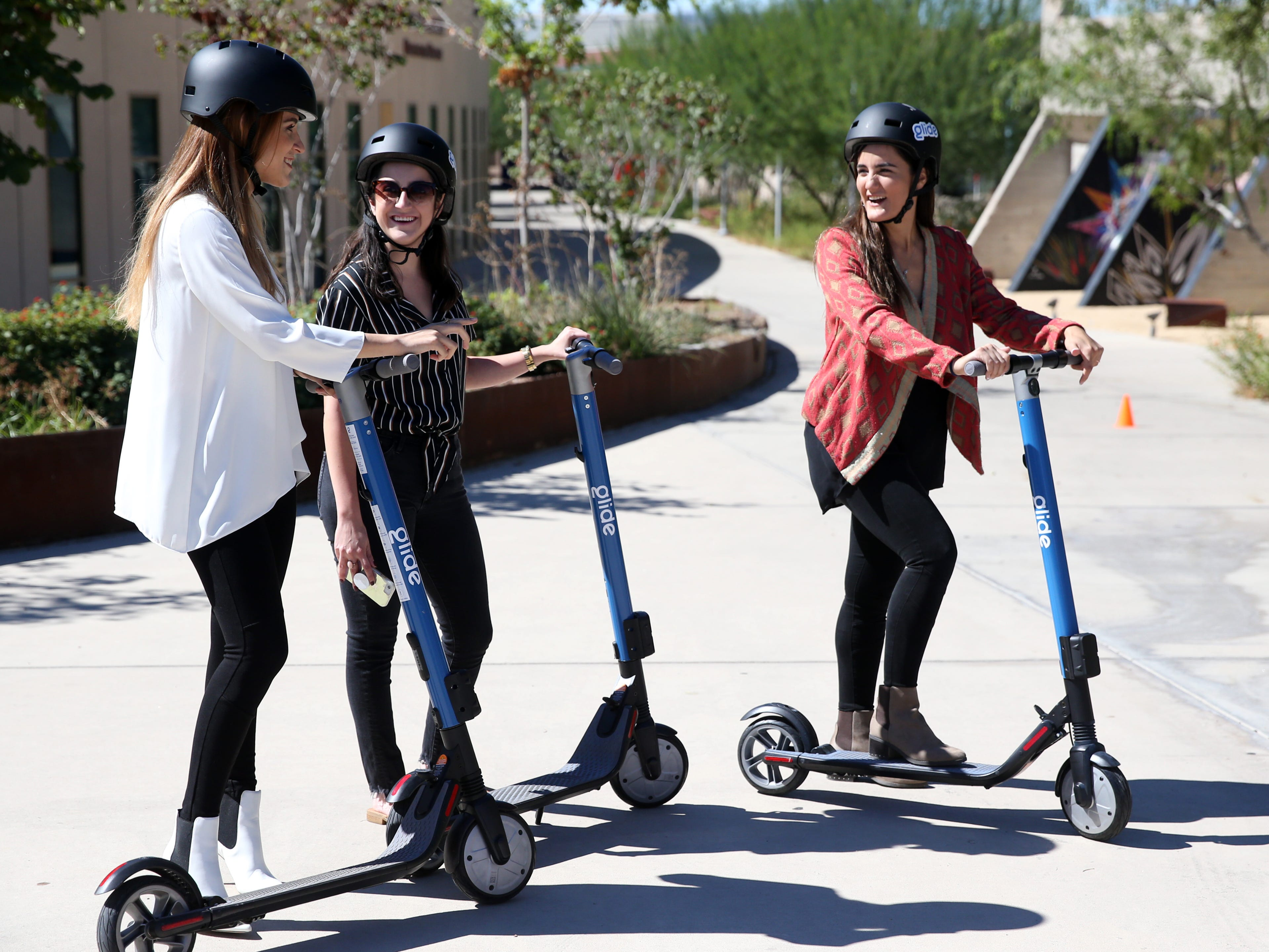 Monica Valdez, from left, Jackie Padilla and Valeria Amato try out the new Glide scooters at the El Paso convention center during the brand launch on Oct. 9, 2018.