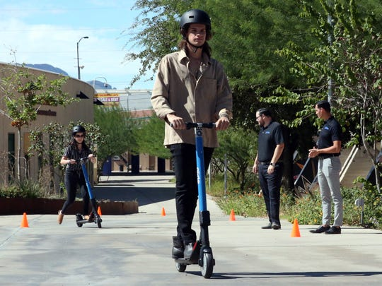 Francisco Alonso rides a scooter from Glide Scooter Sharing LLC on Tuesday in Downtown El Paso.