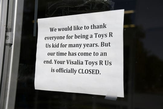 A sign posted to Visalia's Toys R Us announces its closure.