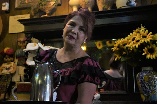 Josefina Reyes, a Las Palmas waitress of 40 years, serves coffee to customers.