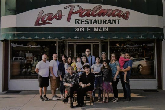 The Cortes clan poses in front of the family restaurant.