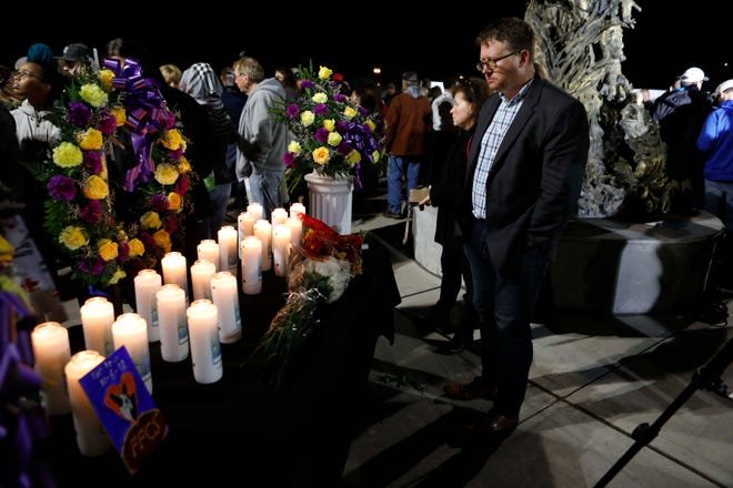 Thousands gather at the The Mohawk Valley Gateway Overlook Bridge in the City of Amsterdam on Oct. 8, 2018, for a candlelight vigil for the 20 people who were killed in a limousine accident in Schoharie on Saturday. on Oct. 8, 2018.