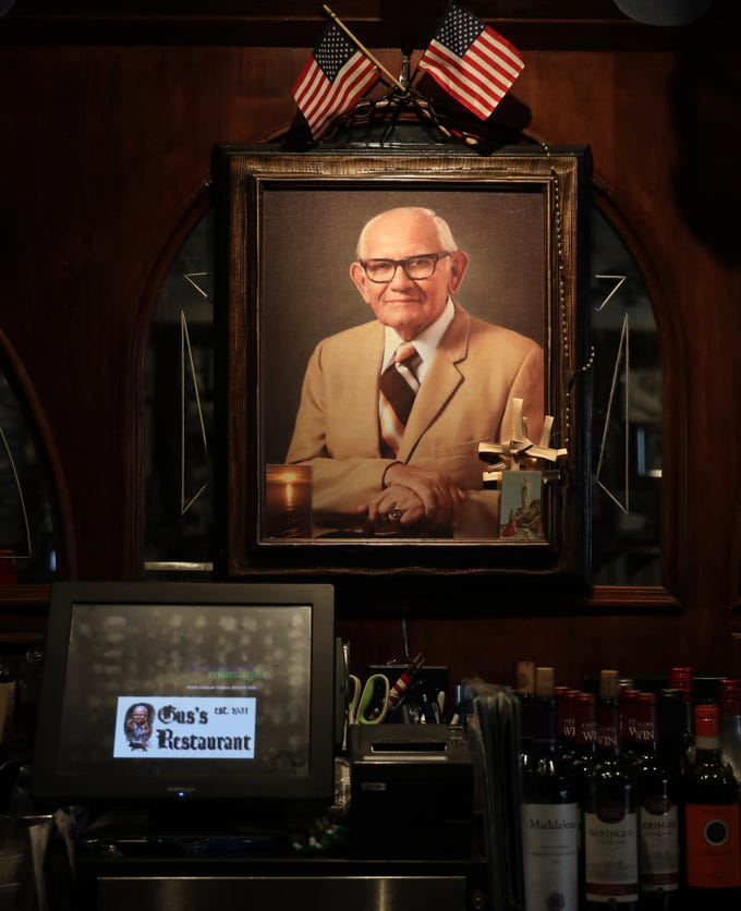 A portrait of Gus hangs behind the bar at Gus's Franklin Park Restaurant on Halstead Avenue in Harrison, pictured Oct. 9, 2018.