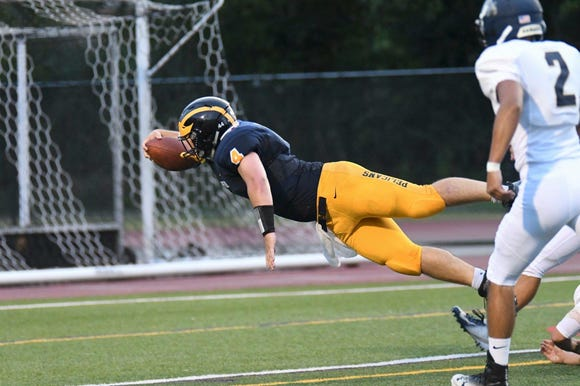 Pelham's Kevin Coleman is pictured reaching for a touchdown.