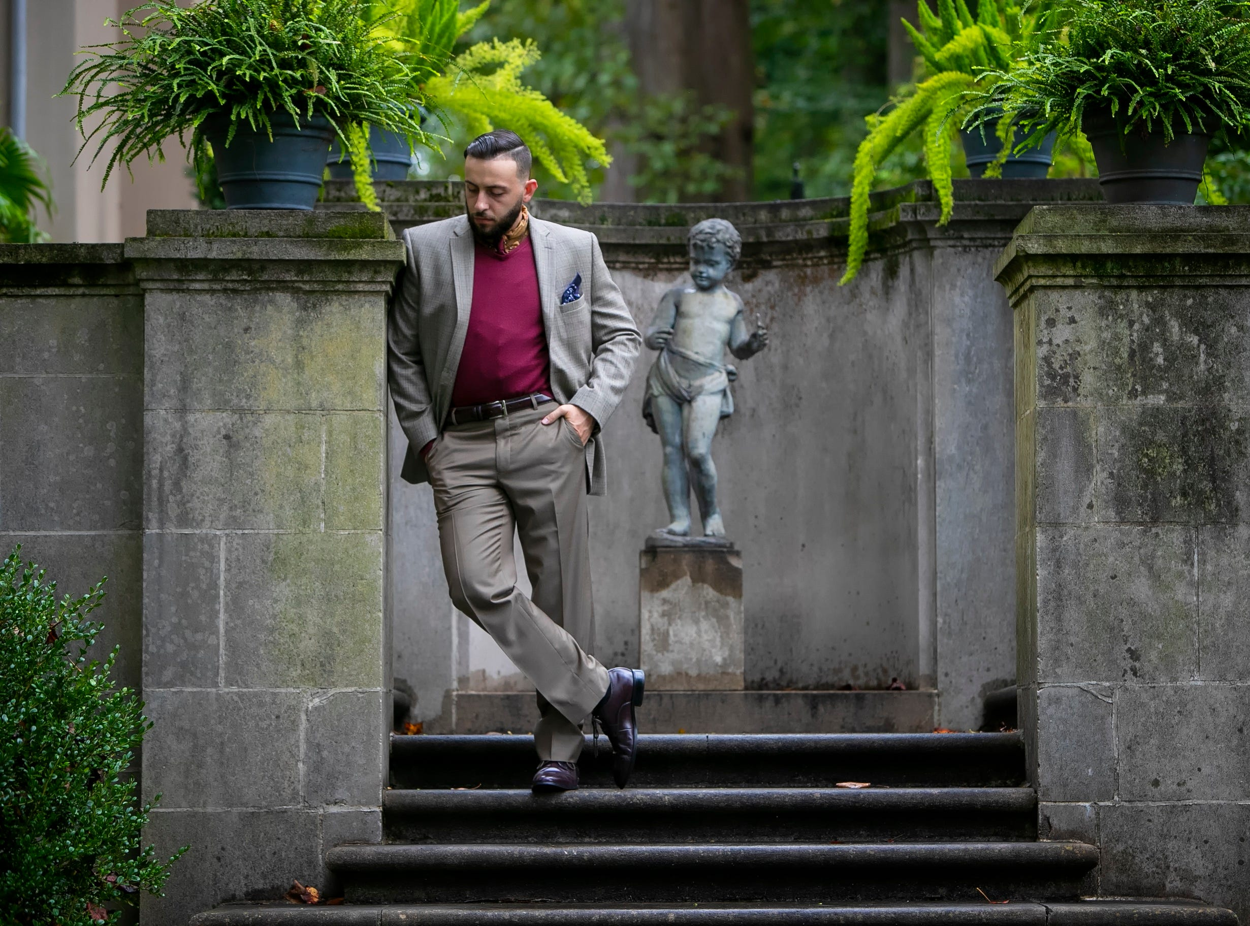 Torrey Malek wears a JoS. A. Bank suit with a Cabela's wilderness game print shirt; maroon marino wool V-neck sweater by John W. Nordstrom; and Joseph Abboud oxblood leather cap-toe shoes.
