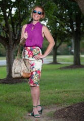 Laura Rimmer wears an amethyst purple sleeveless silk blouse with a high-collar ribbon-tied keyhole by Mossimo; floral pencil skirt from K by Kersh; and Kelly green suede heeled sandals from ZriEy.