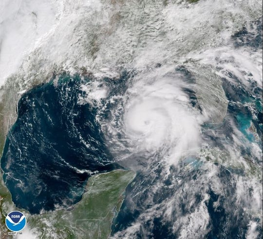 Hurricane Michael is expected to make landfall on the Gulf Coast on Wednesday as a major hurricane. This satellite image shows the storm moving toward land on Tuesday.