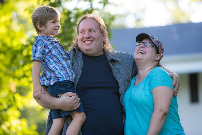 Michael Henderson, Maggie Abercrombie and their son Phoenix at their home in Newark. Maggie Abercrombie had cancer in her early 30s. She preserved her eggs and once she was cancer free went off medication early in order to have her son Phoenix.