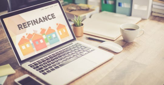 Refinancing a mortgage to obtain a lower interest rate can provide major savings over time.