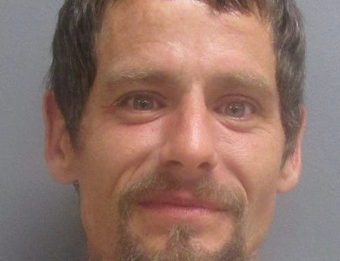 """Carl Bowen said he smile for his mug shot because he felt the charges were """"absurd."""""""