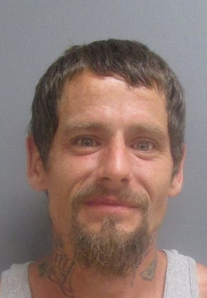 """Carl Bowen said he smile for his mugshot because he felt the charges were """"absurd."""""""