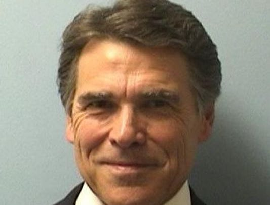 Former Texas Gov. Rick Perry smiled for his mug shot in 2014. Two years later Texas' highest court dismissed the case against Perry